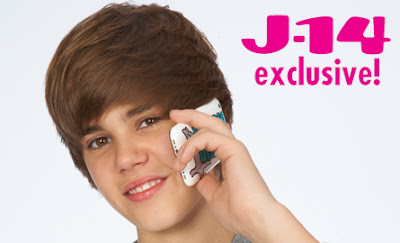 Justin Bieber Holding A Cell Phone