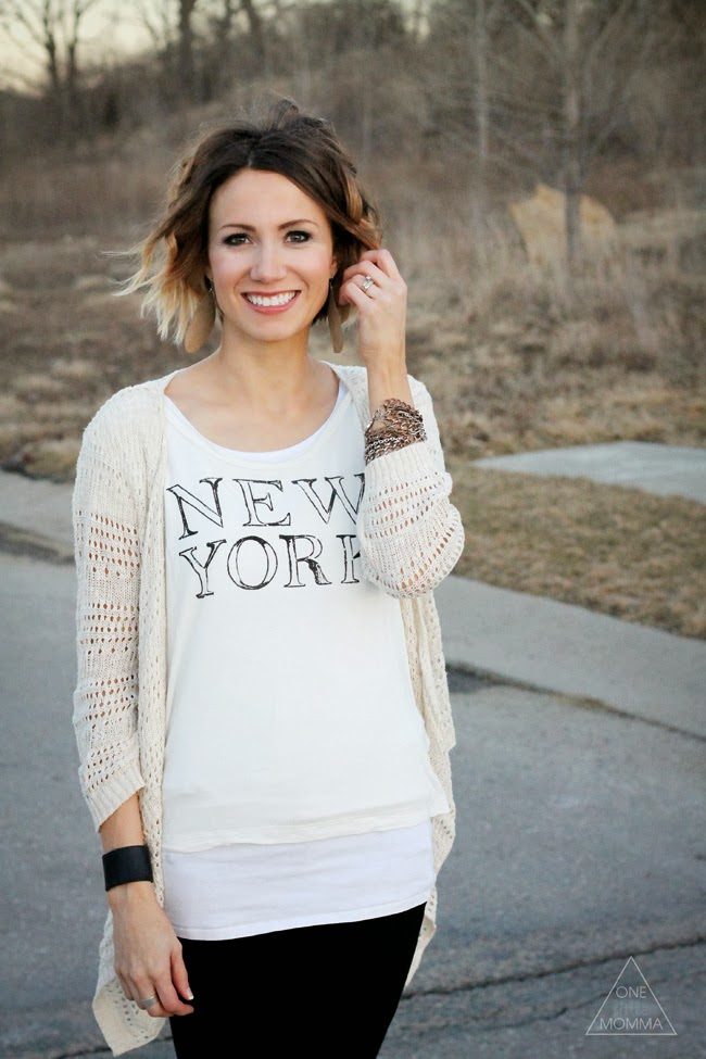 Cream graphic tee, loose cardigan and strappy flats