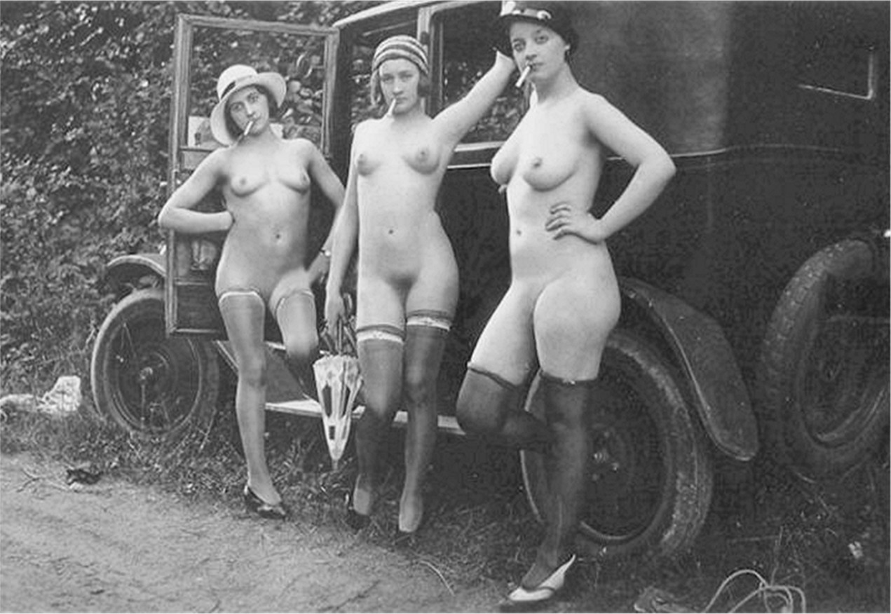 Here We Have Vintage Nude Women Standing In Front Of An Old Truck
