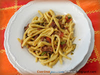 Strozzapreti con speck zucchine e pomodorini