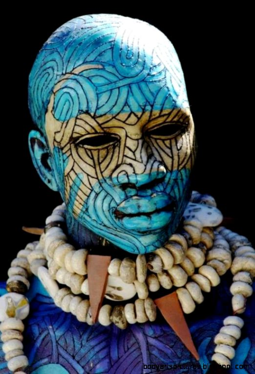 Tribal body art  not sure if this is African  Multi cultural