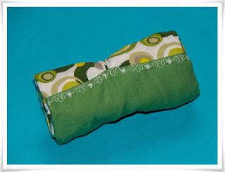 Dekorsöm på gröna tygkassen