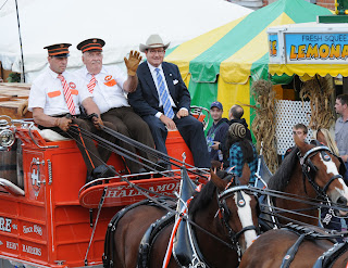 ESE President Eugene Cassidy riding with the Hallamore Clydesdales