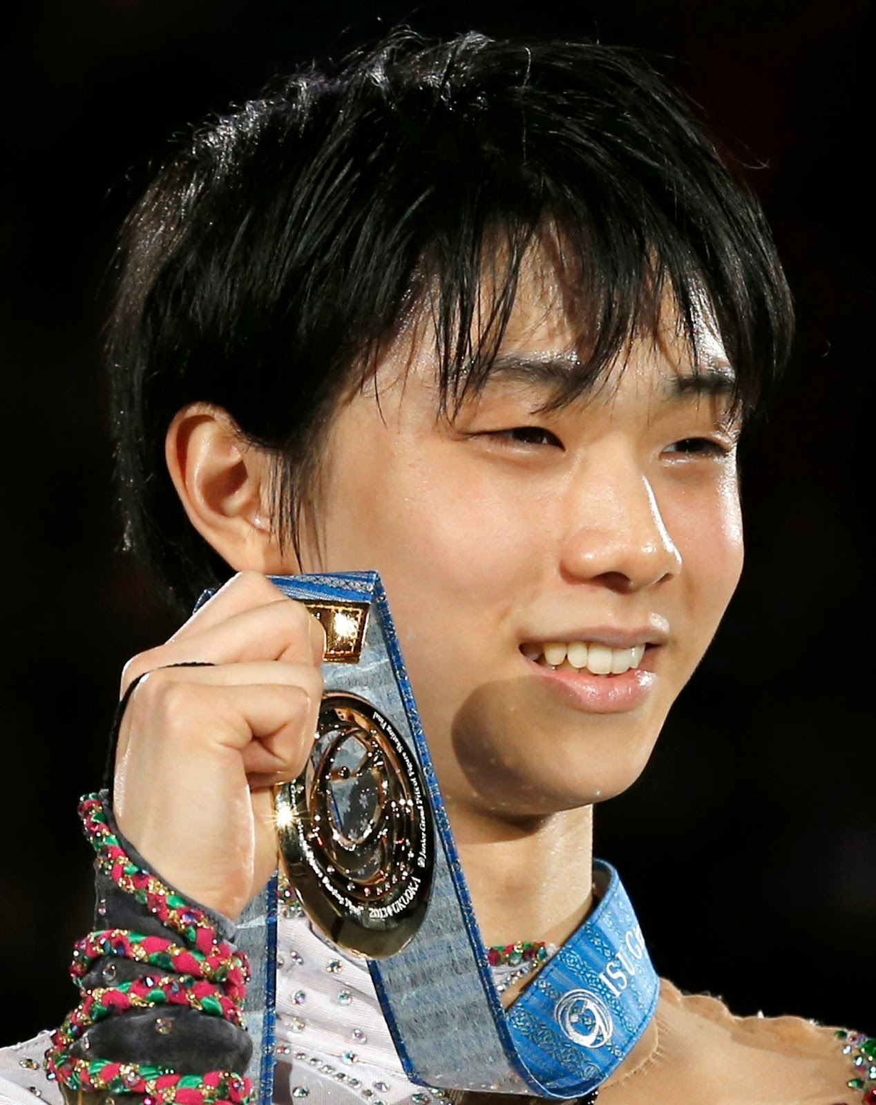 http://www.japantimes.co.jp/sports/2013/12/06/figure-skating/hanyu-shows-impressive-poise-world-class-talent-in-grand-prix-final-triumph/#.UwJ2487X8Us