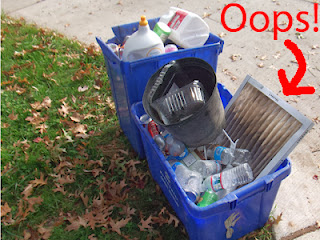 Furnace filter in blue recycling bin set out for collection