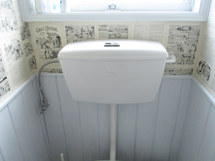 Quirky toilet makeover - plenty to read while on the throne