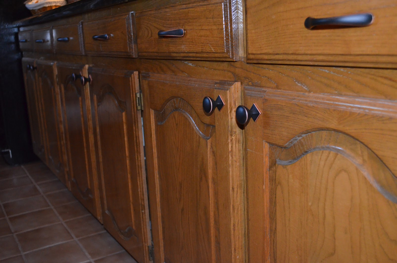 Oak Cabinets with Bronze Hardware