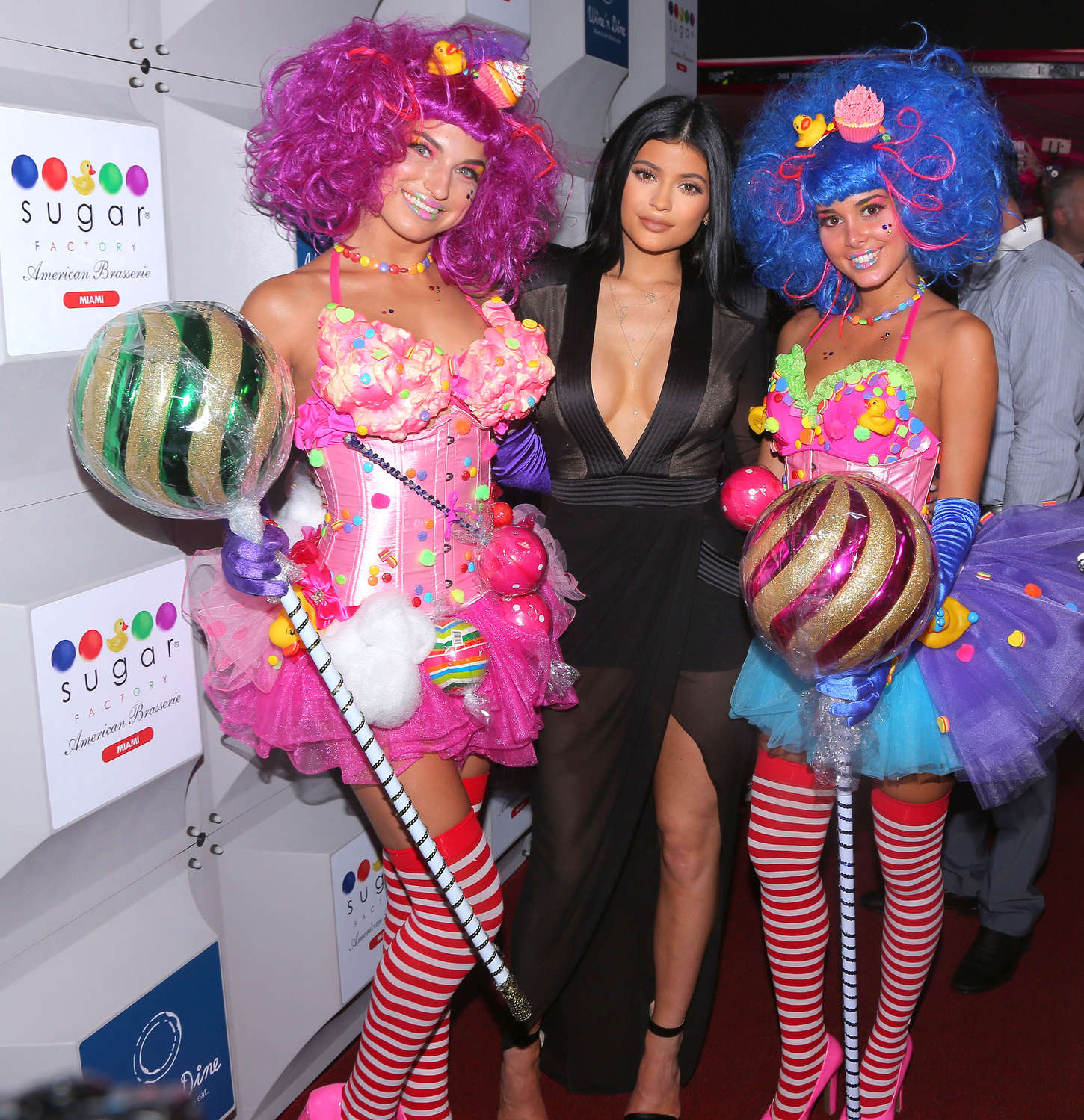 Kylie Jenner in a plunging dress at the Sugar Factory Opening in Miami Beach