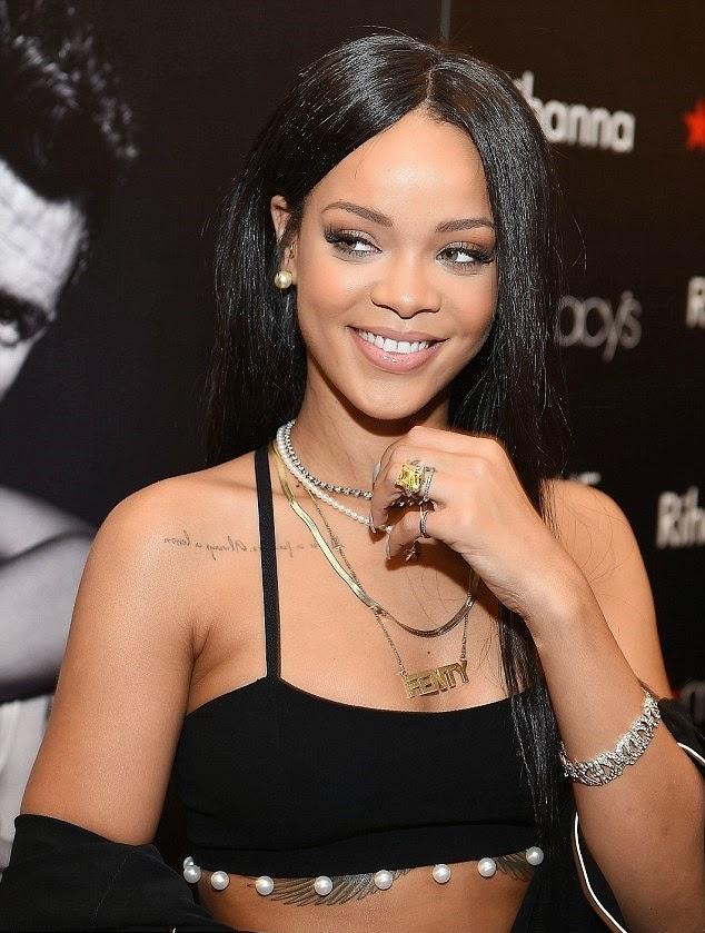 Rihanna in a black Adam Selman attire in Atlanta