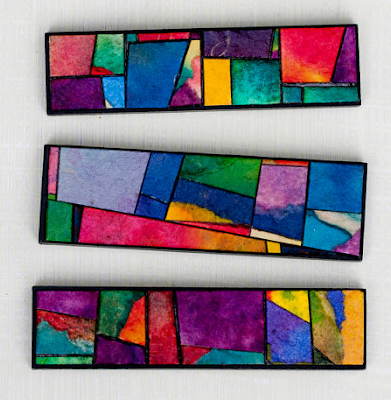 magnets covered in colorful handmade paper