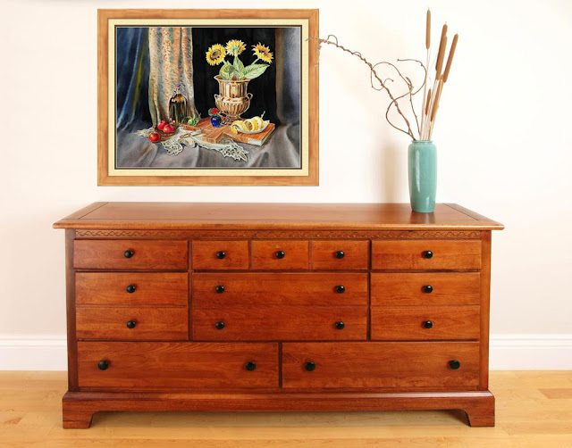 http://irina-sztukowski.artistwebsites.com/products/still-life-with-sunflowers-lemon-apples-and-geranium-irina-sztukowski-framed-print.html