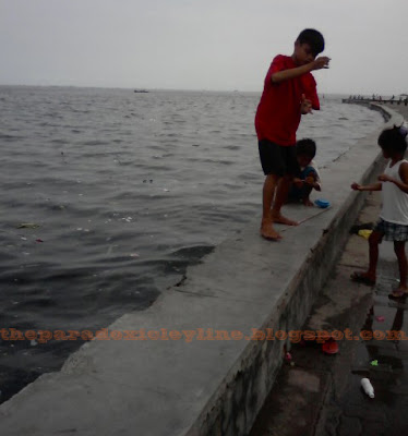 fishing for lunch in Manila Bay