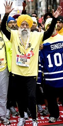 101-year Old Fauja Singh with the Olympic torch