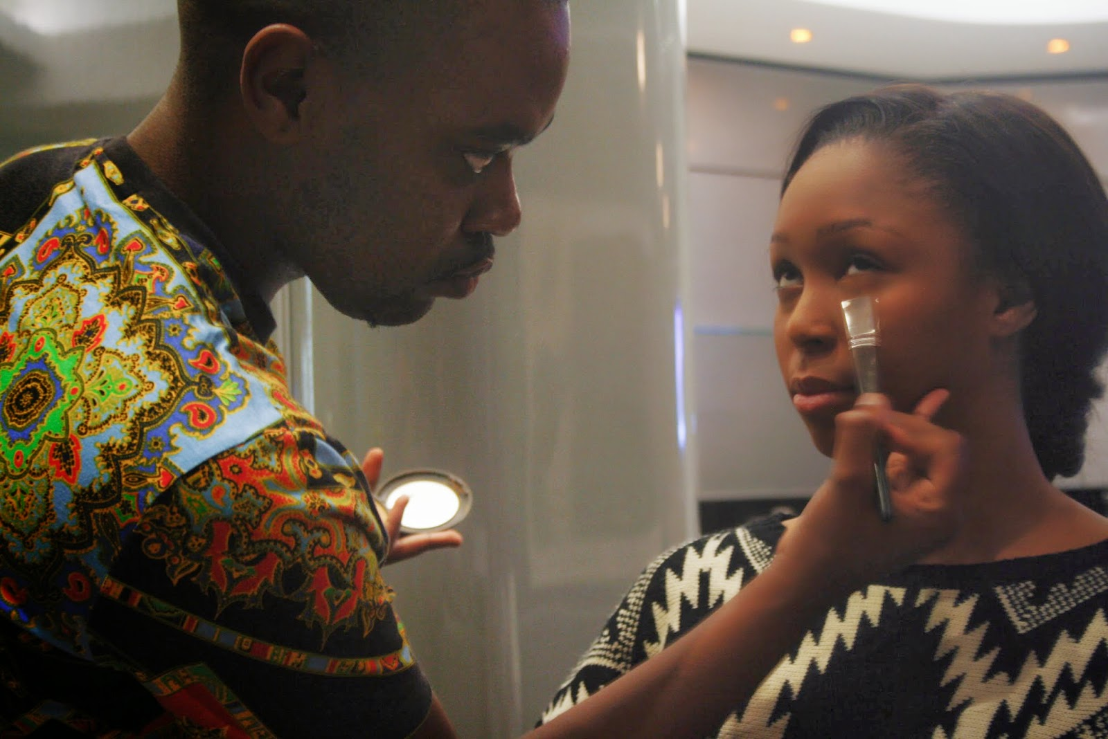 minnie dlamini getting her makeup done