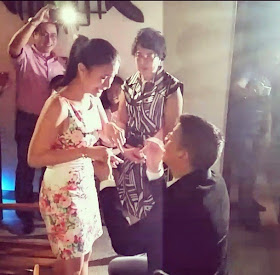 Escudero down on one knee, handing Evangelista an engagement ring