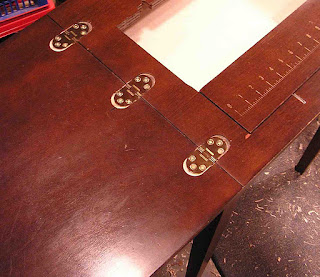Sewing machine table hinge fitted