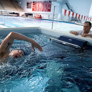 Tim Murphy coaches Olympic swimmer Alex Myer in the Elite Endless Pool