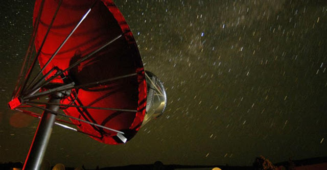 A single antenna of the Allen Telescope Array at night. Photo Credit: Courtesy of ATA, a SETI Institute. Photo taken by Seth Shostak.