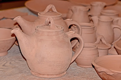 clay teapots waiting to be fired