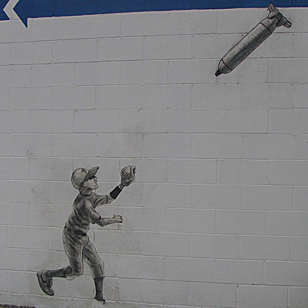 street art in Pasadena California - Little League boy tries to catch incoming missile