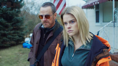 Alice Eve and Bryan Cranston in Cold Comes the Night