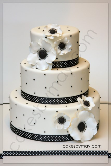 This elegant white and black cake design was adorned by the beautiful