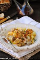 Alcachofas con patatas salteadas y cebolla confitada