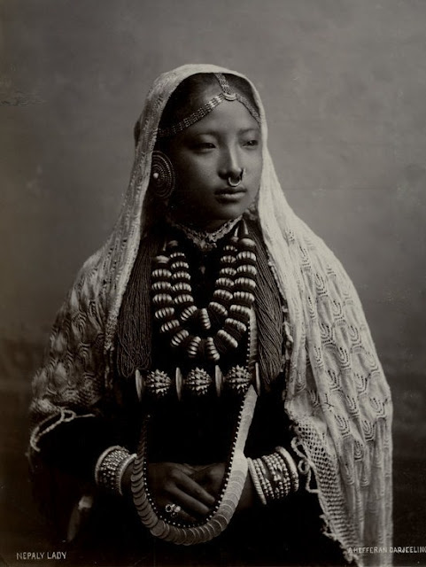 Nepali lady wearing traditional jewelry, vintage photo