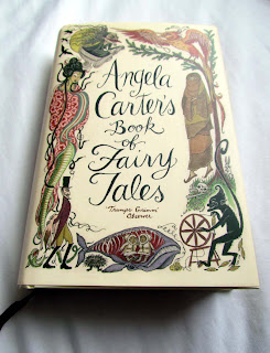 pretty, book covers, beautiful, awesome, good, paperback, hardback, photograph, illustrations, stack, pile of books, spines, appreciate, Angela Carter, fairy tales, stories, folk, snake woman, wale, oral history, classic, spinning wheel