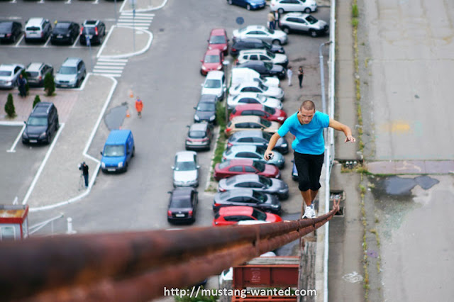 Man walking on a steel wire