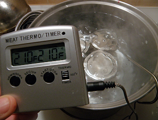 Digital Thermometer in Water Bath Reads Steady at 210 Degrees