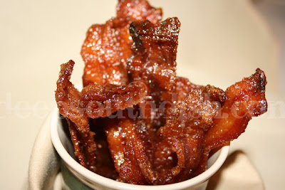 Bacon, glazed with a spicy brown sugar seasoning and baked. Pig Candy!