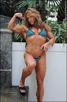 Sheila Bleck Flexing A Bicep With Legs And Calves In High Heels