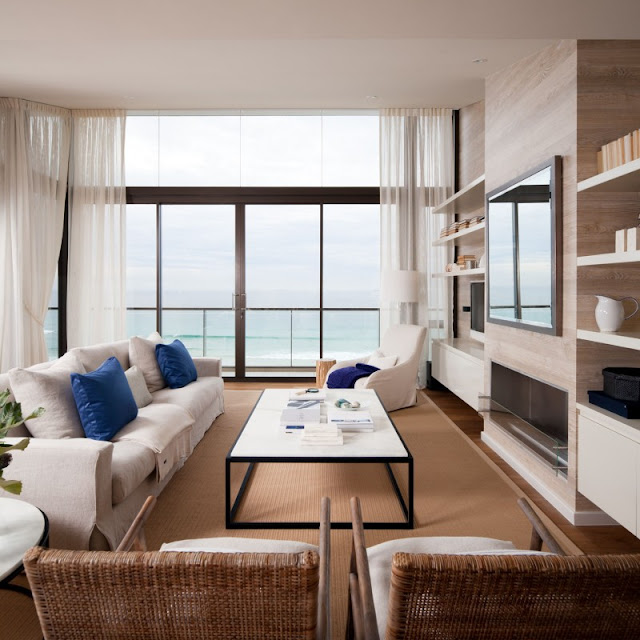 Photo of modern living room furniture by the window with the view