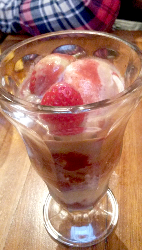 A strawberry sundae dessert.