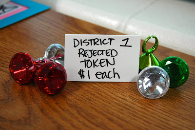From The Capitol General Store: District 1 Rejected Token (Price is in PANEM cash, not real dollars!)
