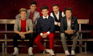 The wax statues of One Direction at Madame Tusaud's in London