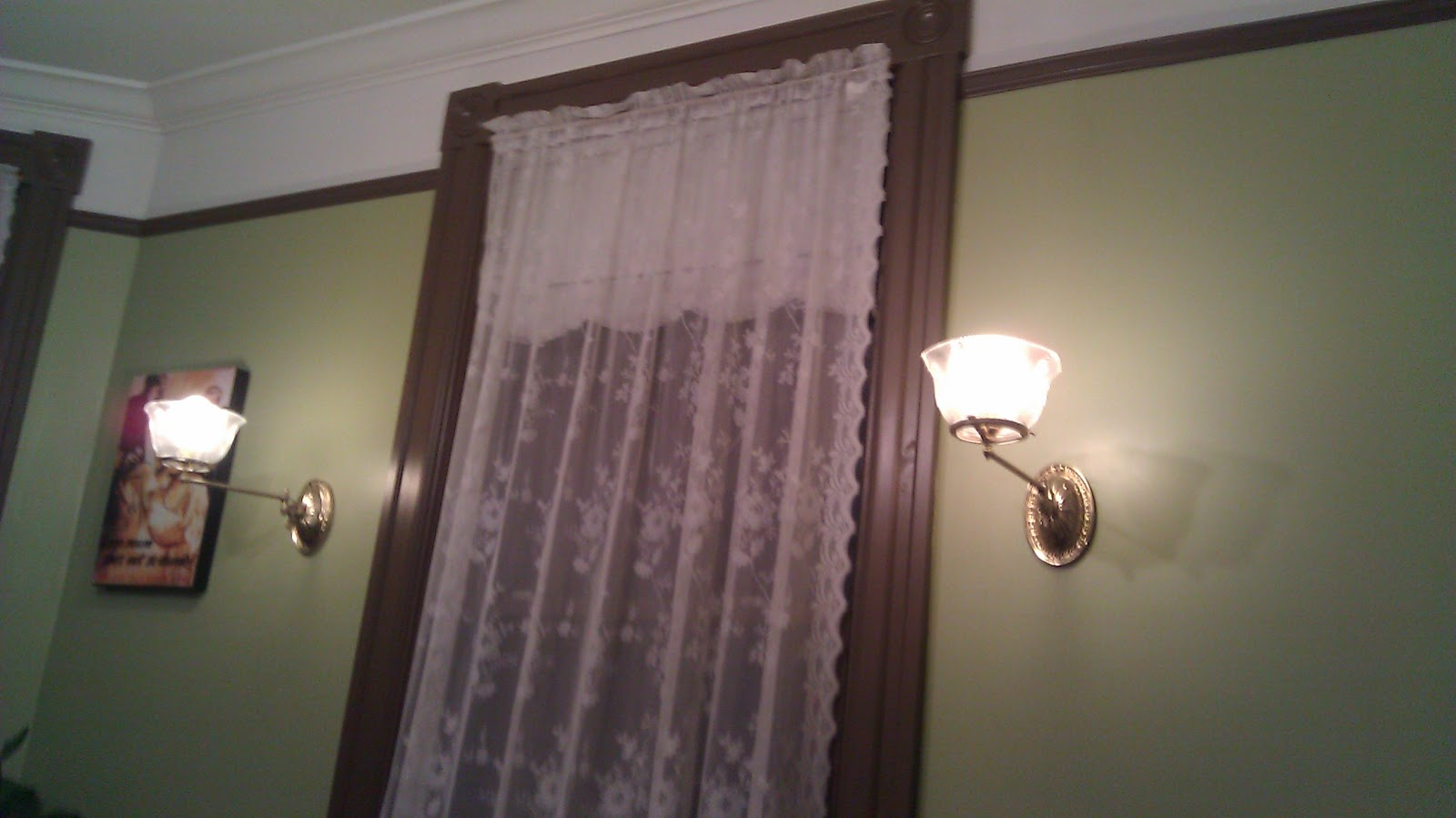 Sconces and light fixture with medallion below