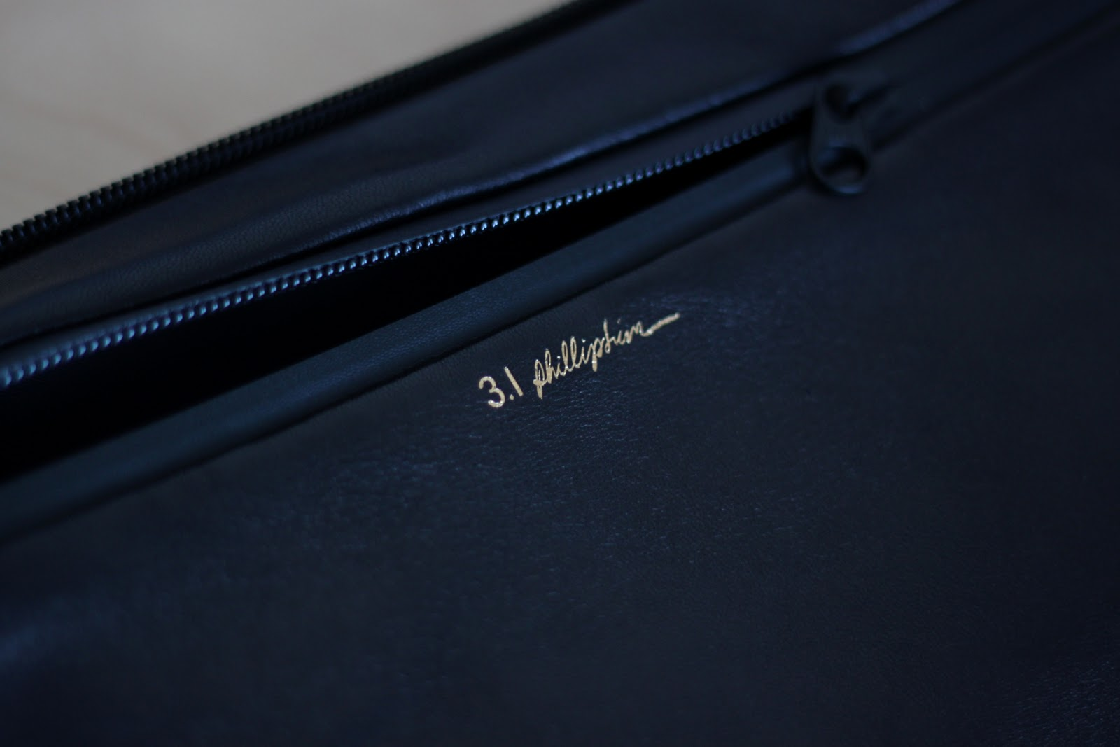 Zip detail on 3.1 Phillip Lim neoprene and leather clutch