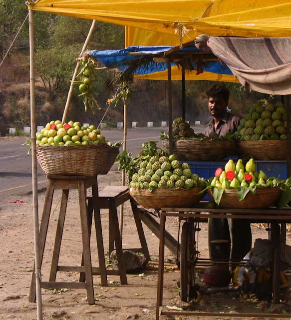 fruit vendor selling guavas and custard apples