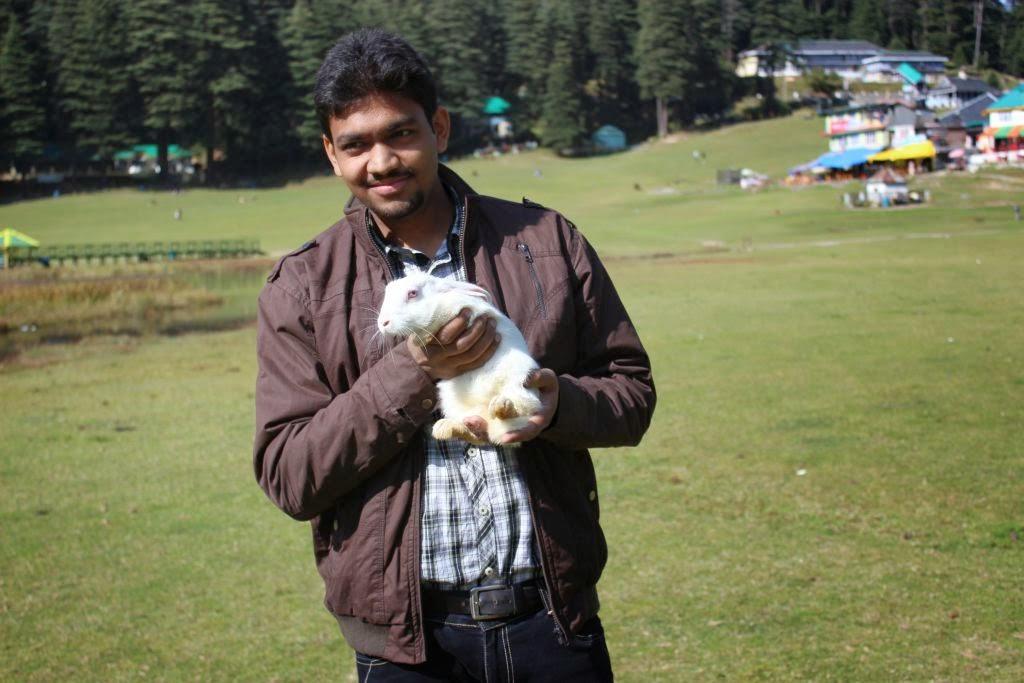 Divyam holding a cute rabbit