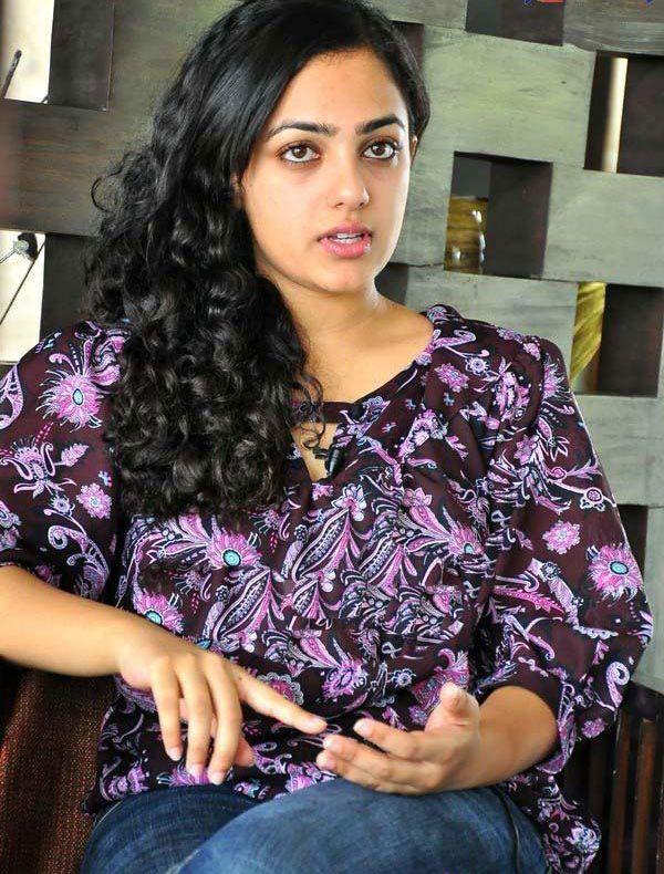Nitya Menon  Telugu Actress Latest Cute Stills Photogallery navel show