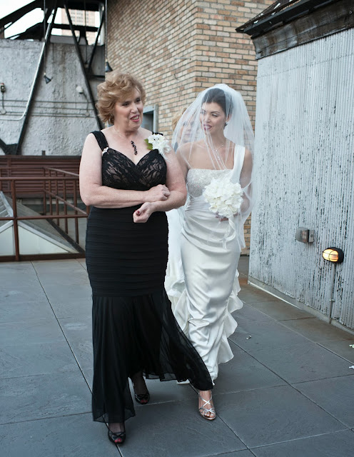 A Model Wedding, mom giving away bride at rooftop wedding