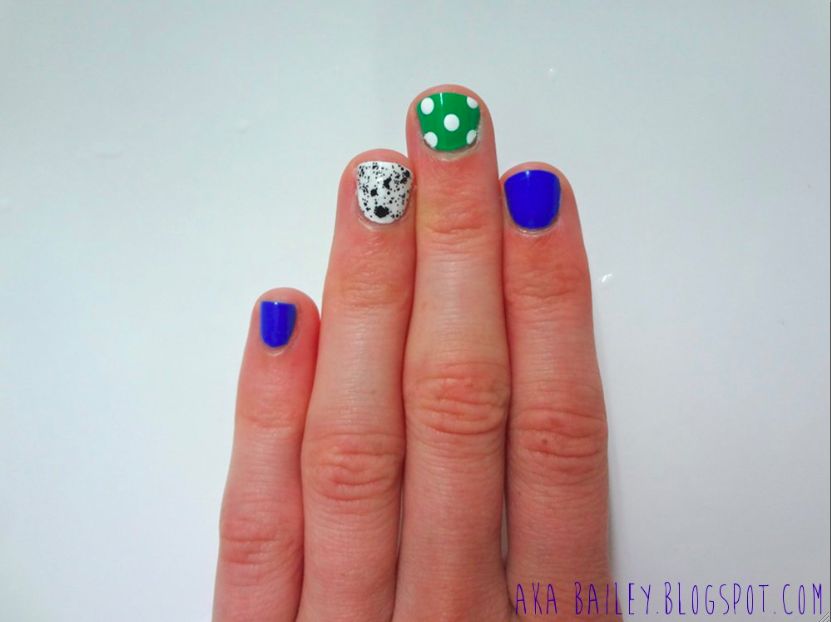 Blue nail polish, two accent nails, polka dots on green nail