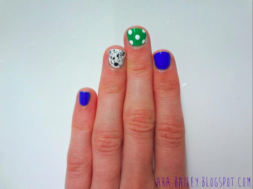Blue nail polish, two accent nails, polka dots on green nail