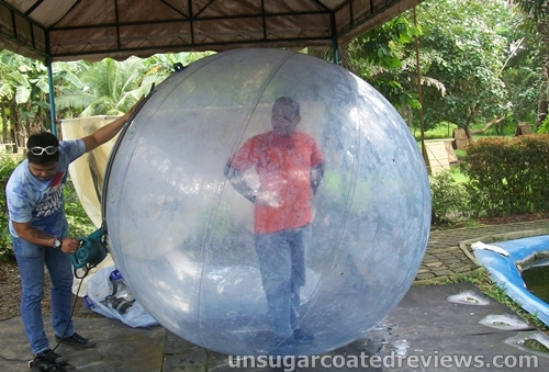 giant ball being inflated at the Walk n' Water Ball Park in Davao City, Philippines