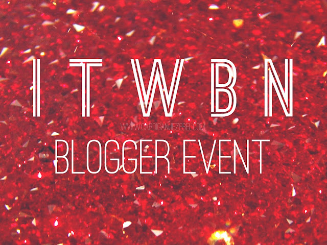 "White geometric text reading ""ITWBN Blogger event"" Over a red glitter/crystal background"