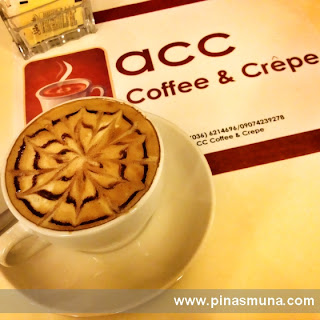 caffe latte by ACC Coffee & Crepe