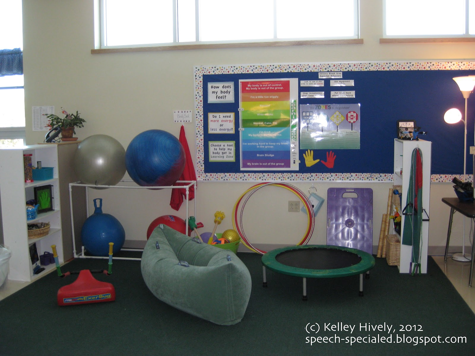 the learning zone and zones of regulation tools are on the bulletin board the therapy balls and hippity hops are stored on the ball rack break room bulletin board