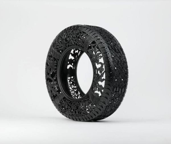 wim-delvoyes-incredible-rubber-carvings-turn-tires-into-art 1